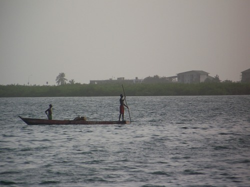 Fishermen in Cockle Bay -- the view from the porch. The bay is quite shallow and is at moderately high tide in this picture. The buildings in the background are at Lumley Beach and are farther than they look