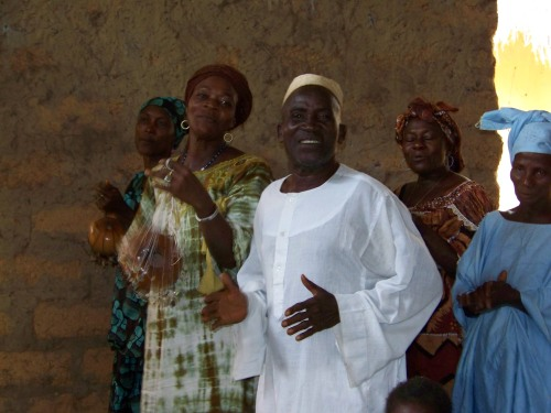This Muslim community leader joined in  the singing of songs about Jesus during a meeting to organize for the water well project.