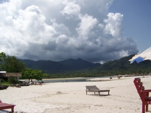More white sand,  where the waterway called #2 River meets the ocean and the mountains meet the sky.