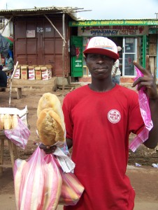 Two loaves sell for 35 cents.  This vendor asked to have his picture taken when he saw my camera.