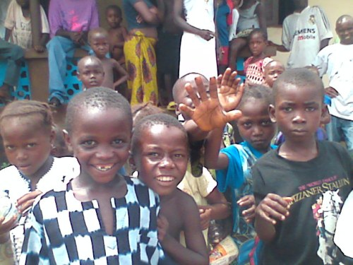 Waving goodbye to the pumwe in Yegele.  (I snapped this with my cell phone's camera after my regular camera quit working, as I really wanted some photos of the children in Yegele.)